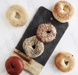 Various kinds of bagels on a marble backdrop