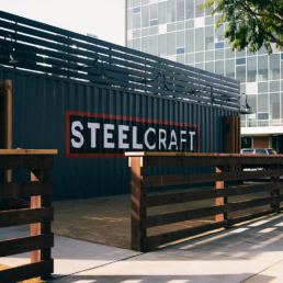 The SteelCraft logo painted on the side of a steel container