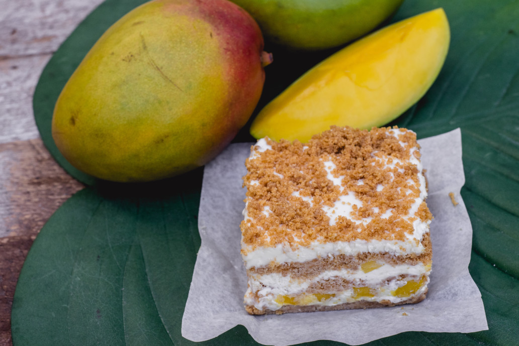 Multiple fruits and a coffee cake