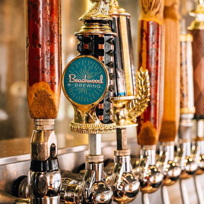 Multiple taps of Beachwood Brewing beers all lined up together