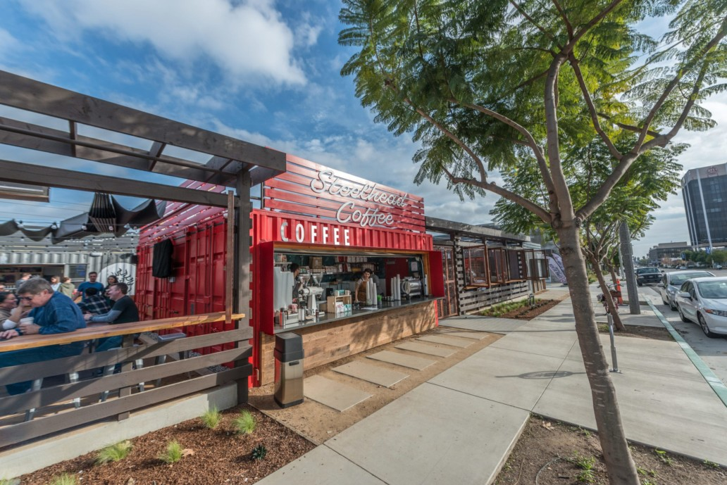 An exterior shot of SteelCraft Long Beach featuring the Steelhead Coffee container open to the sidewalk.